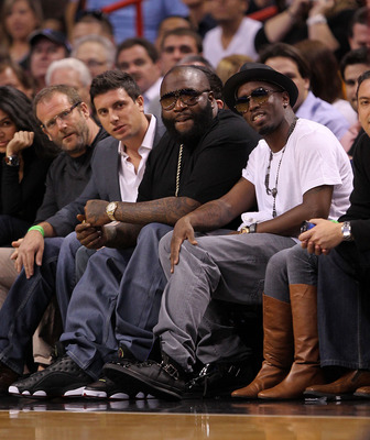 MIAMI, FL - JANUARY 31:  Sean 'P Diddy' Combs(R) and rapper Rick Ross watches a game between the Miami Heat and the Cleveland Cavaliers at American Airlines Arena on January 31, 2011 in Miami, Florida. NOTE TO USER: User expressly acknowledges and agrees