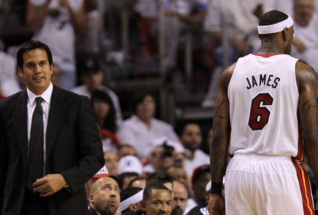 MIAMI, FL - MAY 31:  Head coach Erik Spoelstra of the Miami Heat looks on as LeBron James #6 walks by against the Dallas Mavericks in Game One of the 2011 NBA Finals at American Airlines Arena on May 31, 2011 in Miami, Florida. NOTE TO USER: User expressl