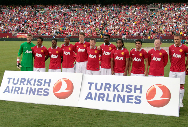 LANDOVER, MD - JULY 30: Members of Manchester United pose for a group photo before the start of their friendly match against Barcelona at FedExField on July 30, 2011 in Landover, Maryland.  Manchester United won 2-1. (Photo by Rob Carr/Getty Images)
