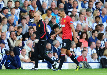 WEST BROMWICH, ENGLAND - AUGUST 14: Rio Ferdinand of Manchester United is substituted during the Barclays Premier League match between West Bromwich Albion and Manchester United at The Hawthorns on August 14, 2011 in West Bromwich, England.  (Photo by Mik