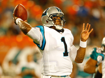 MIAMI GARDENS, FL - AUGUST 19:  Cam Newton #1 of the Carolina Panthers makes a pass during a Preseason NFL game against the Miami Dolphins at Sun Life Stadium on August 19, 2011 in Miami Gardens, Florida.  (Photo by Mike Ehrmann/Getty Images)