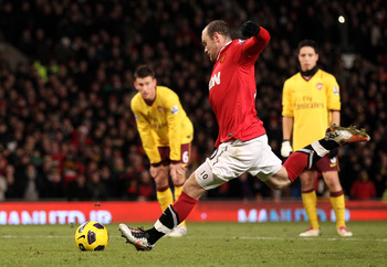 MANCHESTER, ENGLAND - DECEMBER 13:  Wayne Rooney of Manchester United takes and subsequently misses a penalty kick during the Barclays Premier League match between Manchester United and Arsenal at Old Trafford on December 13, 2010 in Manchester, England.