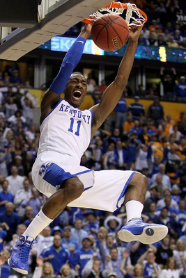 NASHVILLE, TN - MARCH 13:  John Wall #11 of the Kentucky Wildcats dunks against the Tennessee Volunteers during the semirfinals of the SEC Men's Basketball Tournament at the Bridgestone Arena on March 13, 2010 in Nashville, Tennessee.  (Photo by Andy Lyon