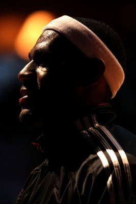 MIAMI, FL - JUNE 12:  LeBron James #6 of the Miami Heat looks on against the Dallas Mavericks in Game Six of the 2011 NBA Finals at American Airlines Arena on June 12, 2011 in Miami, Florida. NOTE TO USER: User expressly acknowledges and agrees that, by d