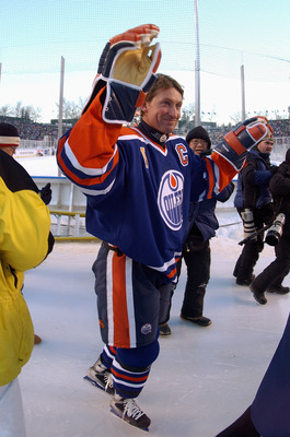 EDMONTON, CANADA - NOVEMBER 22:  Wayne Gretzky #99 of the Edmonton Oilers waves to the fans during the Molson Canadien Heritage Classic against the Montreal Canadiens on November 22, 2003 at Commonwealth Stadium in Edmonton, Canada. The Oilers defeated th