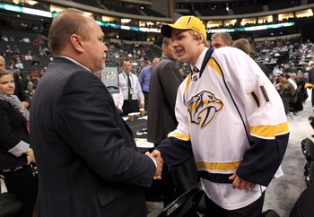 ST PAUL, MN - JUNE 25:  Head coach Barry Trotz of the Nashville Predators shakes hands with Miikka Salomaki drafted 52nd overall by the Predators during day two of the 2011 NHL Entry Draft at Xcel Energy Center on June 25, 2011 in St Paul, Minnesota.  (Ph