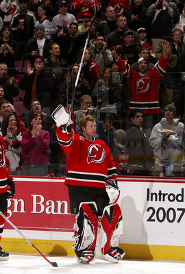 EAST RUTHERFORD, NJ - FEBRUARY 03:  Martin Brodeur #30 of the New Jersey Devils salutes the crowd during pre game ceremonies honoring New Jersey's 1995 Stanley Cup championship team before playing the Buffalo Sabres on February 3, 2007 at Continental Airl