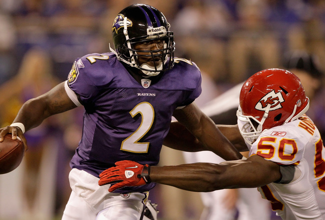 BALTIMORE, MD - AUGUST 19: Quarterback Tyrod Taylor #2 of the Baltimore Ravens is pressured by linebacker Justin Houston #50 of the Kansas City Chiefs during the second half of a preseason game at M&T Bank Stadium on August 19, 2011 in Baltimore, Maryland