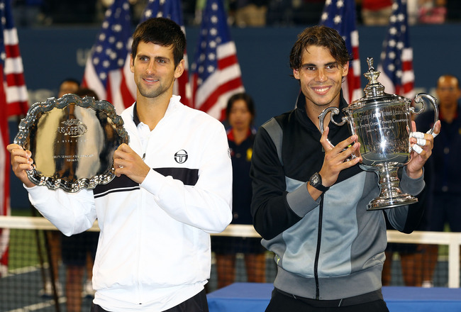 NEW YORK - SEPTEMBER 13:  Rafael Nadal of Spain (R) poses with the championship trophy alongside runner up Novak Djokovic of Serbia (L) after their men's singles final on day fifteen of the 2010 U.S. Open at the USTA Billie Jean King National Tennis Cente
