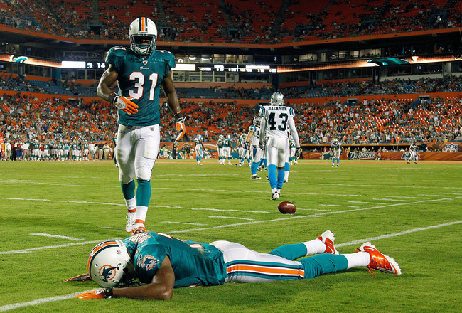 MIAMI GARDENS, FL - AUGUST 19:  Marlon Moore #14 of the Miami Dolphins reacts after missing a pass during a preseason NFL game against the Carolina Panthers at Sun Life Stadium on August 19, 2011 in Miami Gardens, Florida.  (Photo by Mike Ehrmann/Getty Im