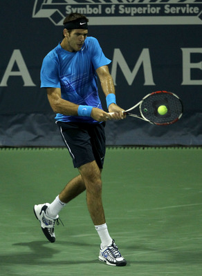 LOS ANGELES, CA - JULY 29:  Juan Martin del Potro of Argentina hits a return to Ernests Gulbis of Latvia during Day 5 of the Farmers Classic presented by Mercedes-Benz at the LA Tennis Center on July 29, 2011 in Los Angeles, California.  (Photo by Stephen