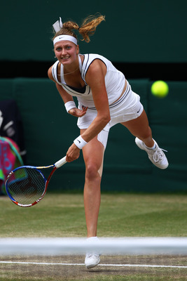 LONDON, ENGLAND - JULY 02:  Petra Kvitova of the Czech Republic serves during her Ladies' final round match against Maria Sharapova of Russia on Day Twelve of the Wimbledon Lawn Tennis Championships at the All England Lawn Tennis and Croquet Club on July