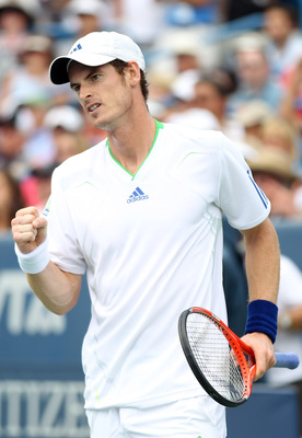 MASON, OH - AUGUST 21:  Andy Murray of Great Britain celebrates after he won the first set against Novak Djokovic of Serbia during the Western & Southern Open at the Lindner Family Tennis Center on August 21, 2011 in Mason, Ohio. Murray won the match afte