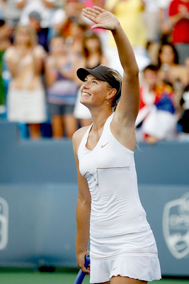 MASON, OH - AUGUST 21:  Maria Sharapova of Russia celebrates her win over Jelena Jankovic of Serbia during the final of the Western & Southern Open at the Lindner Family Tennis Center on August 21, 2011 in Mason, Ohio.  (Photo by Matthew Stockman/Getty Im