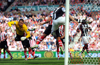 SUNDERLAND, ENGLAND - AUGUST 20:  Ryan Taylor (not pictured) of Newcastle United scores direct from a free-kick past Simon Mignolet of Sunderland during the Barclays Premier League match between Sunderland and Newcastle United at Stadium of Light on Augus