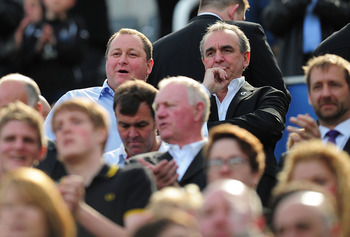 NEWCASTLE UPON TYNE, ENGLAND - MAY 22:  Newcastle owner Mike Ashley (l) looks on before the Barclays Premier League game between Newcastle United and West Bromwich Albion at St James' Park on May 22, 2011 in Newcastle upon Tyne, England.  (Photo by Stu Fo