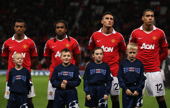 MANCHESTER, ENGLAND - OCTOBER 20:  (L-R) Luis Nani, Anderson, Federico Macheda and Chris Smalling of Manchester United line up with mascots prior to the UEFA Champions League Group C match between Manchester United and Bursaspor Kulubu at Old Trafford on