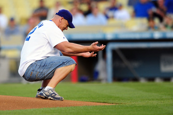 LOS ANGELES, CA - AUGUST 20: WWE Superstar John Cena reacts after throwing the ceremonial first pitch for the Los Angeles Dodgers as they play the Chicago Cubs at Dodger Stadium on August 20, 2009 in Los Angeles, California. (Photo by Jacob de Golish/Gett