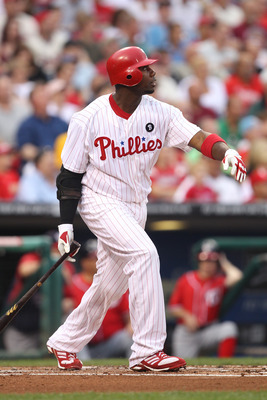 PHILADELPHIA - AUGUST 13: First baseman Ryan Howard #6 of the Philadelphia Phillies watches his first inning two-run home run during a game against the Washington Nationals at Citizens Bank Park on August 13, 2011 in Philadelphia, Pennsylvania. (Photo by