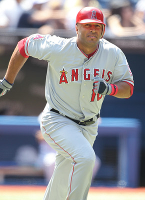TORONTO,CANADA - AUGUST 13:  Vernon Wells #10 of the Los Angeles Angels of Anaheim runs out a hit against the Toronto Blue Jays in a MLB game on August 13,2011 at the Rogers Centre in Toronto, Canada. (Photo by Claus Andersen/Getty Images)