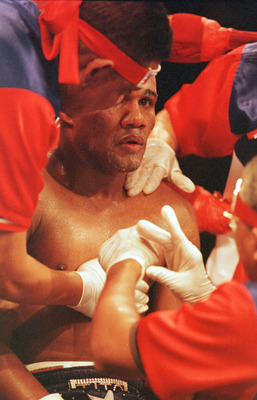 29 Sep 2001:  Felix Trinidad gets worked on in his corner during his bout against Bernard Hopkins at Madison Square Garden in New York, New York.  Hopkins knocked out Trinindad in 12th round. Mandatory Credit: Al Bello/ALLSPORT