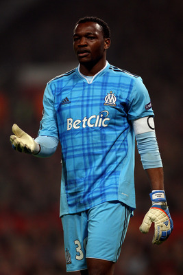 MANCHESTER, ENGLAND - MARCH 15:  Steve Mandanda of Marseille reacts during the UEFA Champions League round of 16 second leg match between Manchester United and Marseille at Old Trafford on March 15, 2011 in Manchester, England.  (Photo by Alex Livesey/Get