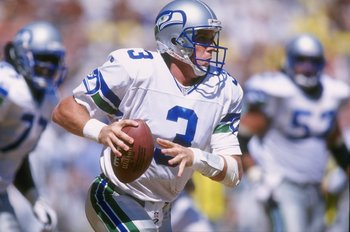 1 Sep 1996:  Quarterback Rick Mirer of the Seattle Seahawks looks down field for an open receiver as he rolls out of the pocket during the Seahawks 29-7 loss to the San Diego Chargers at Jack Murphy Stadium in San Diego, California.  Mandatory Credit: Al