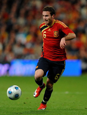 MADRID, SPAIN - MARCH 28:  Juan Mata of Spain runs with the ball during the FIFA2010 World Cup Qualifier match between Spain and Turkey at the Estadio Santiago Bernabeu on March 28, 2009 in Madrid, Spain. Spain won the match 1-0.  (Photo by Jasper Juinen/
