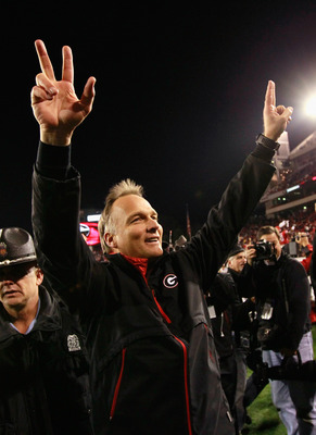 ATHENS, GA - NOVEMBER 27:  Head coach Mark Richt of the Georgia Bulldogs celebrates their 42-34 win over the Georgia Tech Yellow Jackets at Sanford Stadium on November 27, 2010 in Athens, Georgia.  (Photo by Kevin C. Cox/Getty Images)