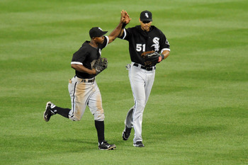 BALTIMORE, MD - AUGUST 11:  Juan Pierre #1 and ALex Rios #51 of the Chicago White Sox celebrates a win after a baseball game against the Baltimore Orioles at Oriole Park at Camden Yards on August 11, 2011 in Baltimore, Maryland.  The White Sox won 6-3. (P