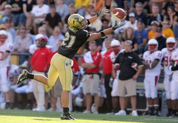 BOULDER, CO - SEPTEMBER 22:  Scotty McKnight # 21 of the Colorado Buffaloes reaches for the catch against the Miami of Ohio Redhawks at Folsom Field on September 22, 2007 in Boulder, Colorado. Colorado defeated Miami of Ohio 42-0. (Photo by Doug Pensinger