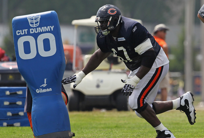 BOURBONNAIS, IL - AUGUST 06:  Chris Spencer #67 of the Chicago Bears works out during a summer training camp practice at Olivet Nazarene University on August 6, 2011 in Bourbonnais, Illinois.  (Photo by Jonathan Daniel/Getty Images)