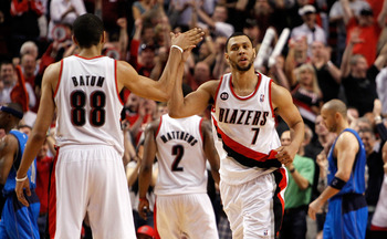 PORTLAND, OR - APRIL 23:  Brandon Roy #7 high fives Nicolas Batum #88 of the Portland Trail Blazers against the Dallas Mavericks in Game Four of the Western Conference Quarterfinals in the 2011 NBA Playoffs on April 23, 2011 at the Rose Garden in Portland