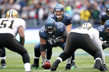 SEATTLE, WA - JANUARY 08:  Center Chris Spencer #65 prepares to snap the football to Matt Hasselbeck #8 of the Seattle Seahawks against the New Orleans Saints during the 2011 NFC wild-card playoff game at Qwest Field on January 8, 2011 in Seattle, Washing