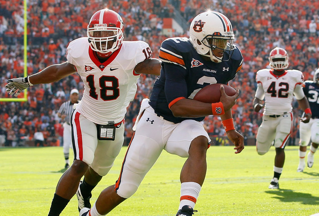 AUBURN, AL - NOVEMBER 13:  Quarterback Cameron Newton #2 of the Auburn Tigers rushes for a touchdown past Bacarri Rambo #18 of the Georgia Bulldogs at Jordan-Hare Stadium on November 13, 2010 in Auburn, Alabama.  (Photo by Kevin C. Cox/Getty Images)