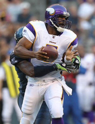 SEATTLE - AUGUST 20:  Quarterback Donovan McNabb #5 of the Minnesota Vikings is sacked by Raheem Brock #98 of the Seattle Seahawks at CenturyLink Field on August 20, 2011 in Seattle, Washington. The Vikings won 20-7. (Photo by Otto Greule Jr/Getty Images)