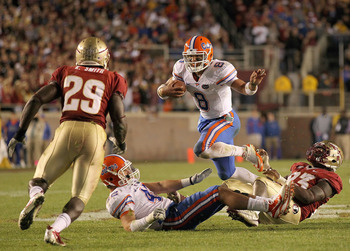 TALLAHASSEE, FL - NOVEMBER 27:  Trey Burton #8 of the Florida Gators rushes   during a game against the Florida State Seminoles at Doak Campbell Stadium on November 27, 2010 in Tallahassee, Florida.  (Photo by Mike Ehrmann/Getty Images)