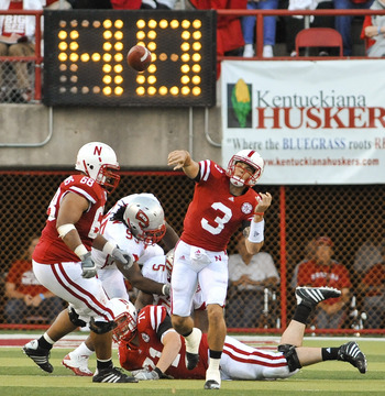 LINCOLN, NE - SEPTEMBER 04: Taylor Martinez #3 of the Nebraska Cornhuskers  passes the ball down field against the Western Kentucky Hilltoppers  during first half action of their game at Memorial Stadium on September 4, 2010 in Lincoln, Nebraska. Nebraska