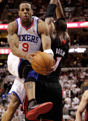 PHILADELPHIA, PA - APRIL 21: Andre Iguodala #9 of the Philadelphia 76ers drives to the basket against Chris Bosh #1 of the Miami Heat during the second half of game three of the Eastern Conference Quarterfinals at Wells Fargo Center on April 21, 2011 in P