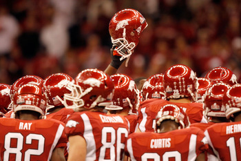 NEW ORLEANS, LA - JANUARY 04:  The Arkansas Razorbacks huddle before taking on the Ohio State Buckeyes during the Allstate Sugar Bowl at the Louisiana Superdome on January 4, 2011 in New Orleans, Louisiana.  (Photo by Matthew Stockman/Getty Images)