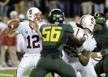 EUGENE, OR - OCTOBER 2: Quarterback Andrew Luck #12 of the Stanford Cardinal sets to throw a pass as linebacker Josh Kaddu #56 of the Oregon Ducks applies pressure in the third quarter of the game at Autzen Stadium on October 2, 2010 in Eugene, Oregon. Or