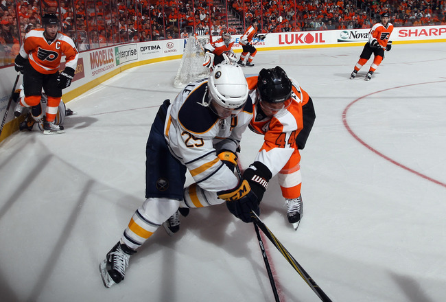 PHILADELPHIA, PA - APRIL 14: Jason Pominville #29 of the Buffalo Sabres and Kimmo Timonen #44 of the Philadelphia Flyers battle for the puck in Game One of the Eastern Conference Quarterfinals during the 2011 NHL Stanley Cup Playoffs at Wells Fargo Center