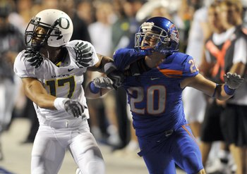 BOISE, ID - SEPTEMBER 3:  Willie Glasper #17 of the Oregon Ducks battles for position with Mitch Burroughs #20 of the Boise State as a pass is thrown in second quarter of the game on September 3, 2009 at Broncos Stadium in Boise, Idaho. Boise State won th