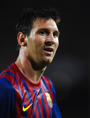 BARCELONA, SPAIN - AUGUST 17:  Lionel Messi of Barcelona looks on during the Super Cup second leg match between Barcelona and Real Madrid at Nou Camp on August 17, 2011 in Barcelona, Spain.  (Photo by Laurence Griffiths/Getty Images)