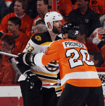PHILADELPHIA, PA - APRIL 30: Chris Pronger #20 of the Philadelphia Flyers and Zdeno Chara #33 of the Boston Bruins battle in Game One of the Eastern Conference Semifinals during the 2011 NHL Stanley Cup Playoffs at the Wells Fargo Center on April 30, 2011