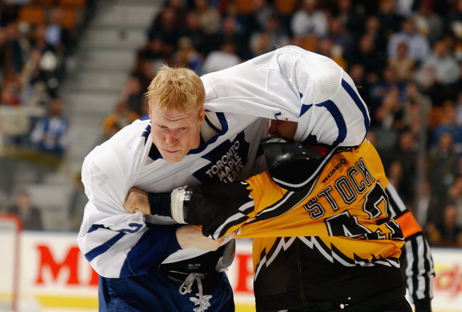TORONTO - NOVEMBER 19:  Wade Belak #2 of the Toronto Maple Leafs fights with P.J. Stock #42 of the Boston Bruins during the NHL game at the Air Canada Center on November 19, 2002 in Toronto, Canada.  The Maple Leafs won 2-0.  (Photo By Dave Sandford/Getty