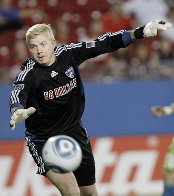 FRISCO, TX - AUGUST 20: Goalkeeper Kevin Hartman #1 of the FC Dallas dives for the ball during the second half of a soccer game against the Seattle Sounders FC at Pizza Hut Park on August 20, 2011 in Frisco, Texas. Seattle won 1-0. (Photo by Brandon Wade/