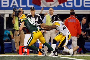 ARLINGTON, TX - FEBRUARY 06:  Jordy Nelson #87 of the Green Bay Packers crosses the goal line for a touchdown reception against the Pittsburgh Steelers during Super Bowl XLV at Cowboys Stadium on February 6, 2011 in Arlington, Texas.  (Photo by Kevin C. C
