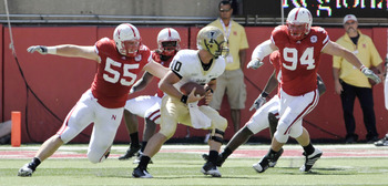 LINCOLN, NEBRASKA - SEPTEMBER 11: Idaho Vandals quarterback Nathan Enderle #10 tries to elude Nebraska Cornhuskers defensive tackle Baker Steinkuhler #55 and Nebraska Cornhuskers defensive tackle Jared Crick #94 during first half action of their game at M