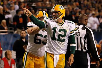 CHICAGO - SEPTEMBER 27:  Aaron Rodgers (R) #12 and Scott Wells #63 of  the Green Bay Packers celebrate after Rodgers scored a 3-yard rushing touchdown in the fourth quarter against the Chicago Bears at Soldier Field on September 27, 2010 in Chicago, Illin